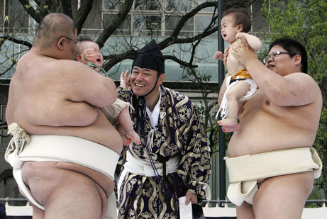 Sumo Wrestlers With Babies