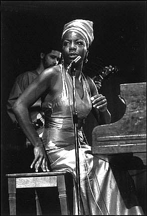 Nina Simone in a lamè turban. The accent is everything